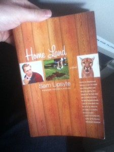 My copy of Home Land on an airplane